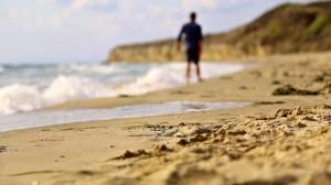 Morning walk on the beautiful beach in summer